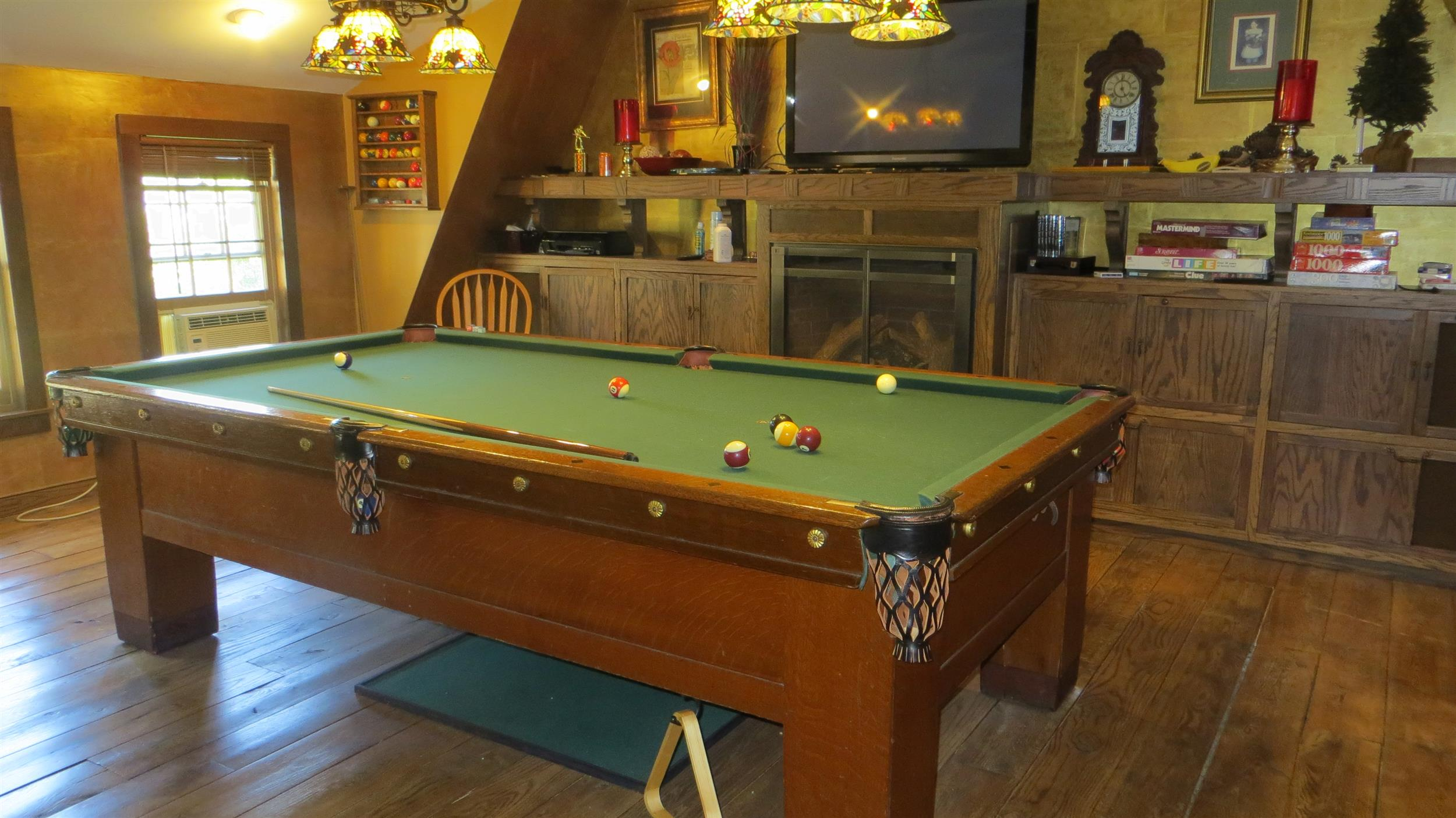 game-room-with-pool-table-and-fireplace.jpg